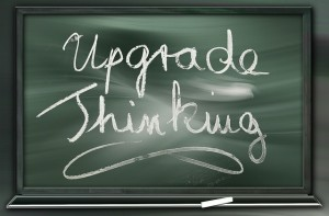schoolbord met de tekst upgrade thinking